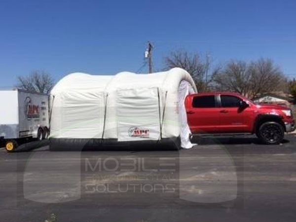 portable bedliner booth red truck