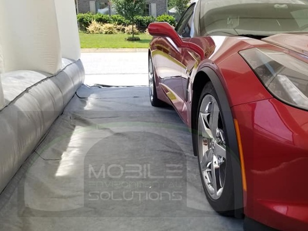 portable car paint booth with red vette